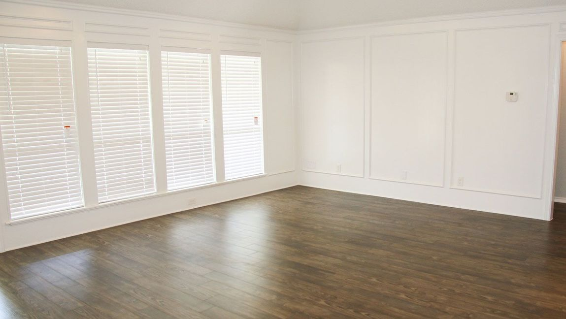 Newly painted room with varnished flooring